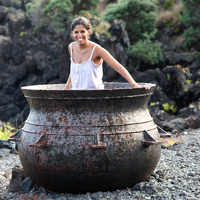 girl sitting in a pot and smiling