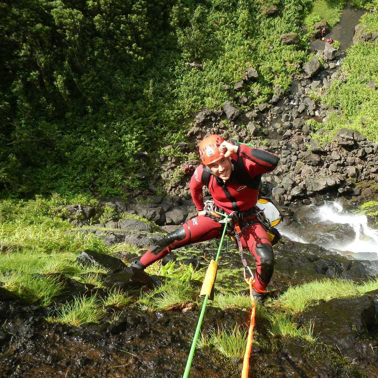 Bruno Silveira from Tobogã Azores, rappelling down. Canyoning is a leisure activity
