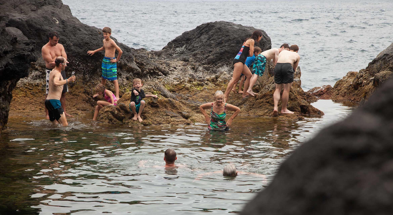 group of people enjoying the beach