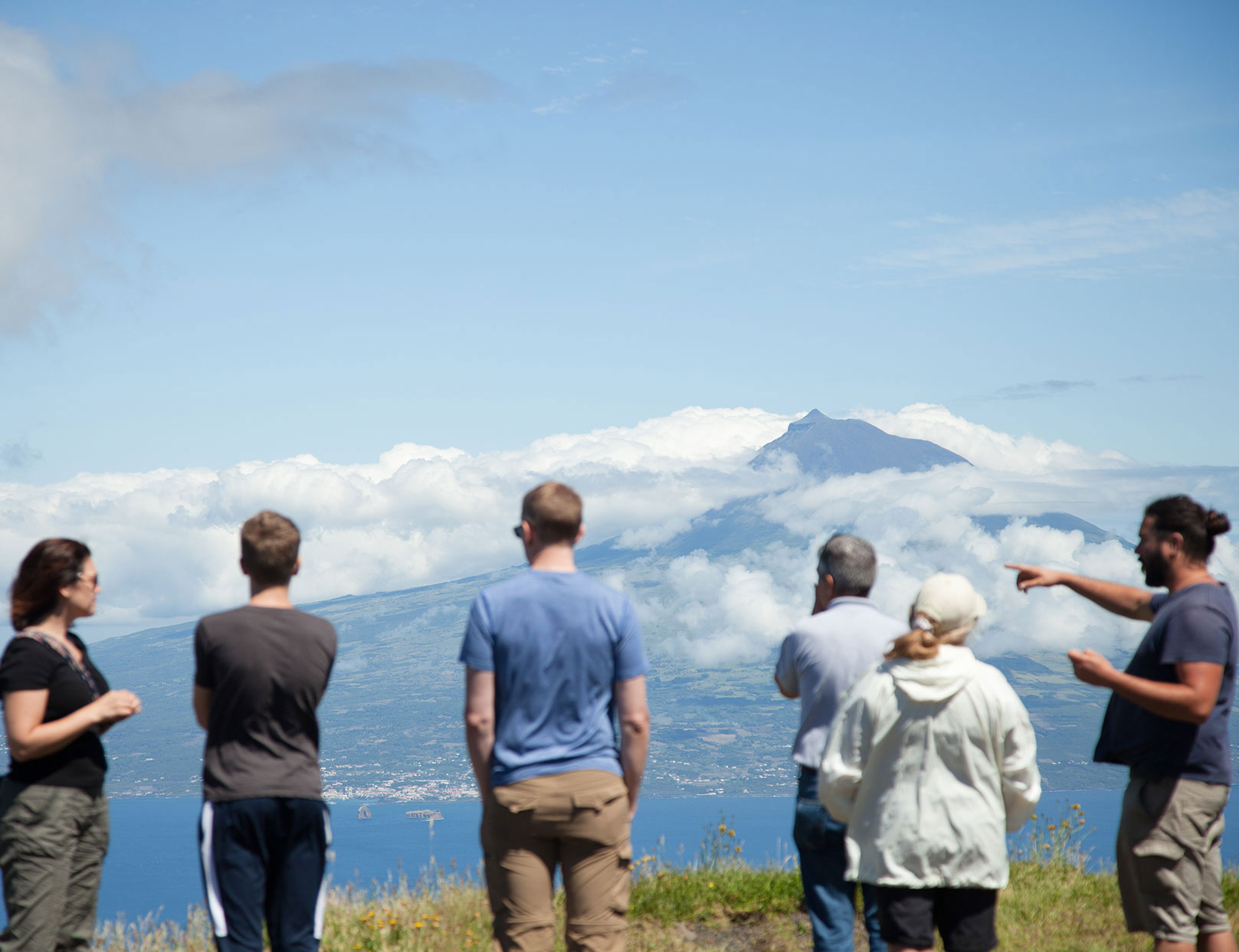 car tour in group of men looking at a volcano